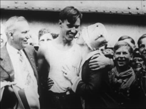 excited boy scout paul sikel hugging parents before expedition to north pole / news. - 1926 stock-videos und b-roll-filmmaterial