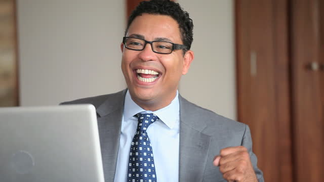 excited businessman celebrating at laptop in office - ecstatic stock videos and b-roll footage