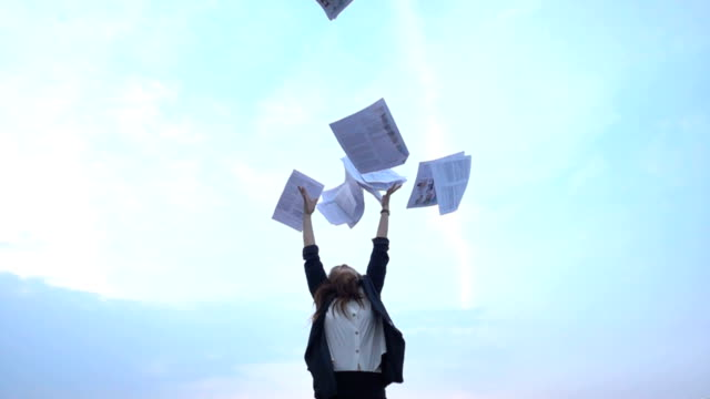 excited businesswoman throwing papers in the air - paperwork stock videos and b-roll footage