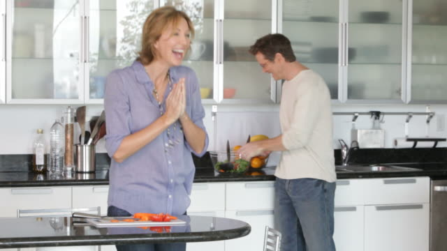 Excited Caucasian woman in kitchen