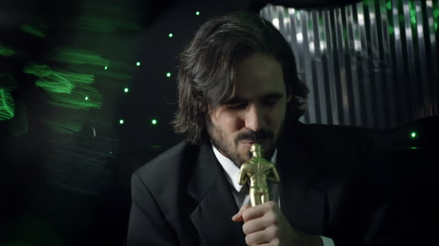 excited celebrity kisses oscar statuette in backseat of limousine at awards show - academy of motion picture arts and sciences stock videos and b-roll footage