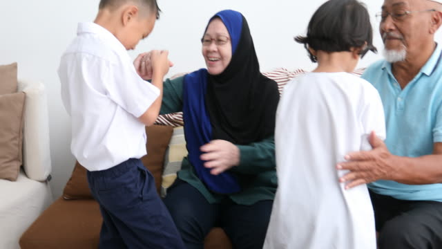 excited children arriving at home to see grandparents - hijab stock videos & royalty-free footage
