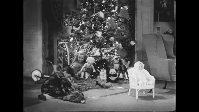 1941 excited children come downstairs to gifts on christmas morning - stockings stock videos & royalty-free footage