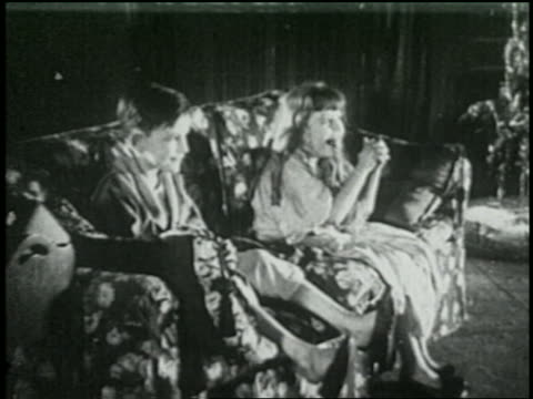 b/w 1925 excited children sitting on couch - 1925 stock videos & royalty-free footage