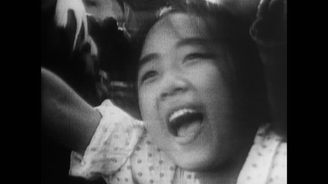 excited chinese civilians jump and scream as the crowd behind them roars - 1966 stock videos & royalty-free footage
