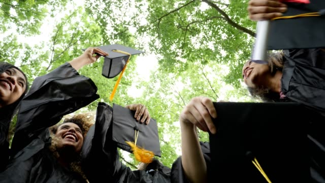 excited college graduates - graduation stock videos & royalty-free footage