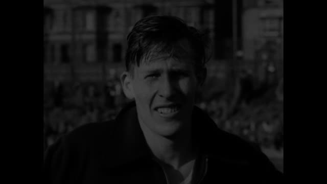 excited crowd applauding / roger bannister stands with man / sot bannister with analysis of race / chris brasher roger bannister christopher chataway... - end cap stock videos & royalty-free footage