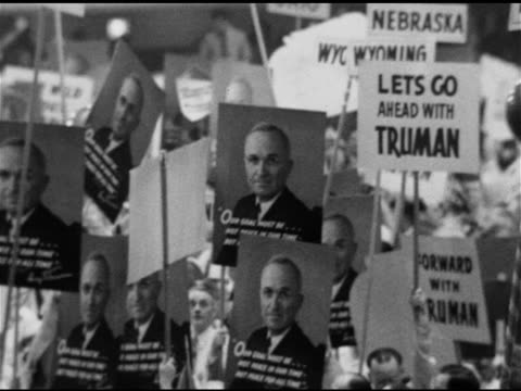 excited delegates w/ photo posters & slogans for truman, 'happy days are here again' playing bg, vs crowd, some w/ balloons on sticks, - 1948 stock videos & royalty-free footage