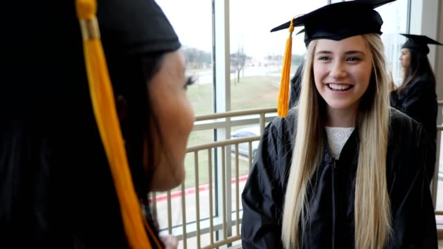 excited female high school graduates - part of stock videos & royalty-free footage