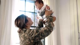 Excited female soldier returns home to her baby girl