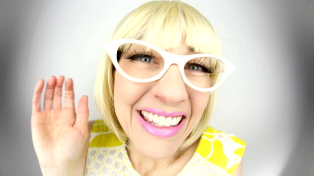 excited fisheye 60's woman - cat's eye glasses stock videos and b-roll footage