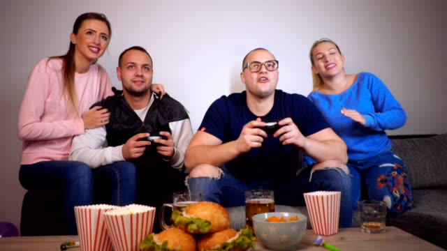 excited friends playing video game - gamepad stock videos & royalty-free footage
