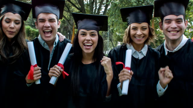 excited group of graduation students celebrating - diploma stock videos and b-roll footage
