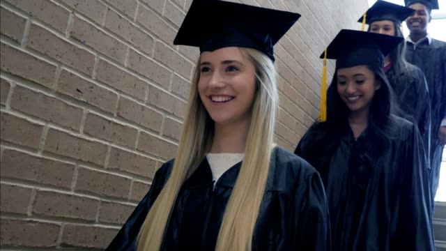 excited group of high school graduates - people in a line stock videos & royalty-free footage