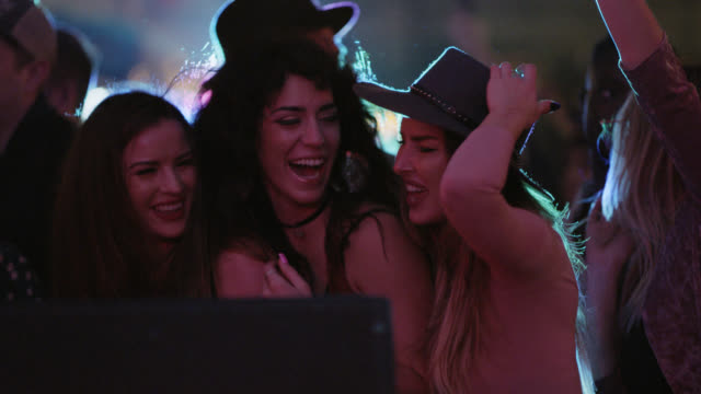 slo mo. excited group of millennial hipsters dance and laugh together on the front row of a concert at a popular music festival - beatnik stock videos & royalty-free footage