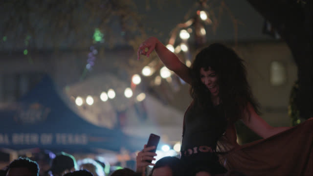 slo mo. excited group of millennial hipsters take a selfie with a bohemian woman riding on the shoulders of her significant other at a popular music festival - selfie stock videos & royalty-free footage