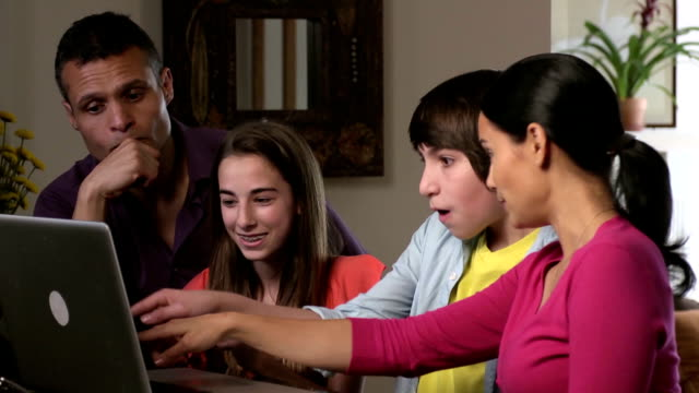 Excited Latin Family Shops & Interacts Online