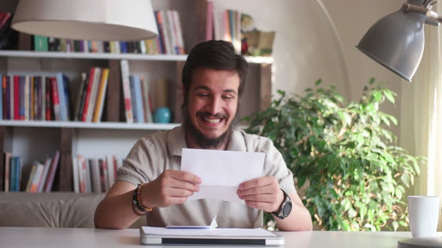 excited male worker entrepreneur opening mail letter reading good news - reading mail stock videos & royalty-free footage