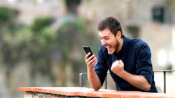 Excited man finding online content on a phone