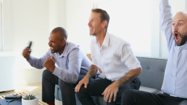 excited men watching sport on television together - only men stock videos & royalty-free footage