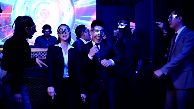 vidéos et rushes de excited multiethnic business people celebrate team success dancing at night club party. - collègue