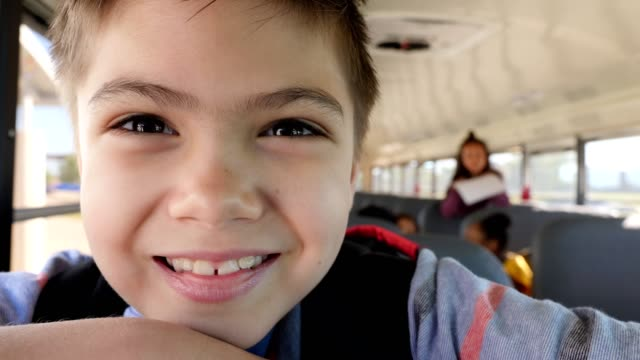excited school boy on school bus - schoolboy stock videos & royalty-free footage