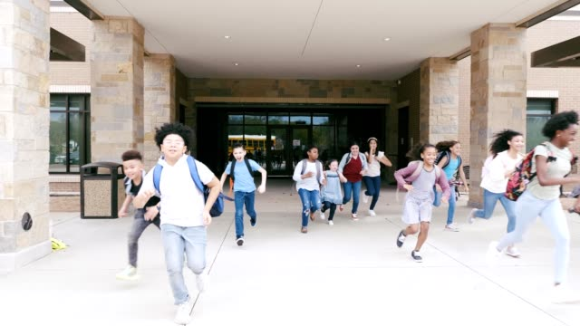 excited schoolchildren leaving school - last day stock videos & royalty-free footage