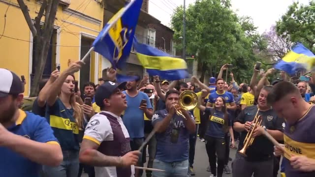Excited supporters of Argentine football team Boca Juniors arrive at the Alberto J Armando stadium known as La Bombonera to watch a historic duel...