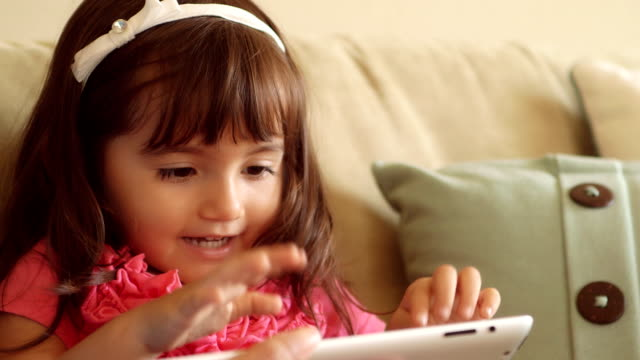 Excited Toddler Making Faces at Tablet