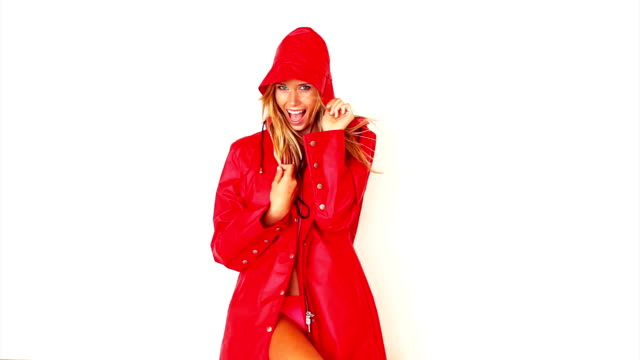 excited woman in red coat - swimming costume isolated stock videos & royalty-free footage