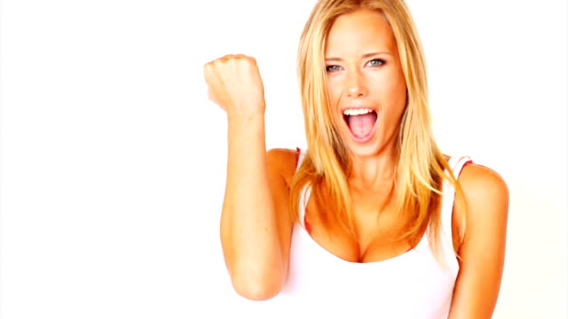 excited young lady celebrating success - blonde hair stock videos & royalty-free footage