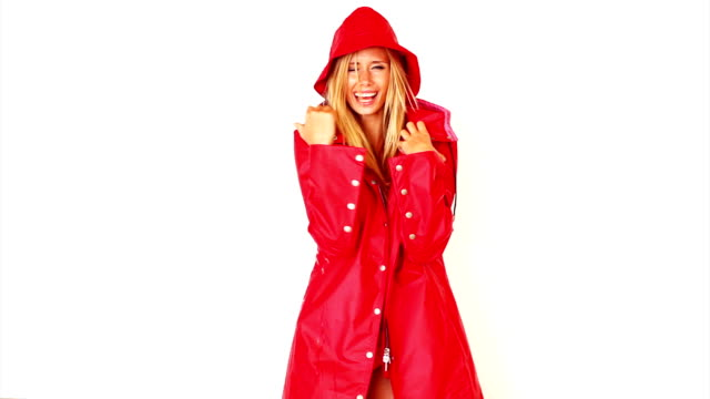 excited young lady wearing red long coat - beautiful woman stock videos & royalty-free footage