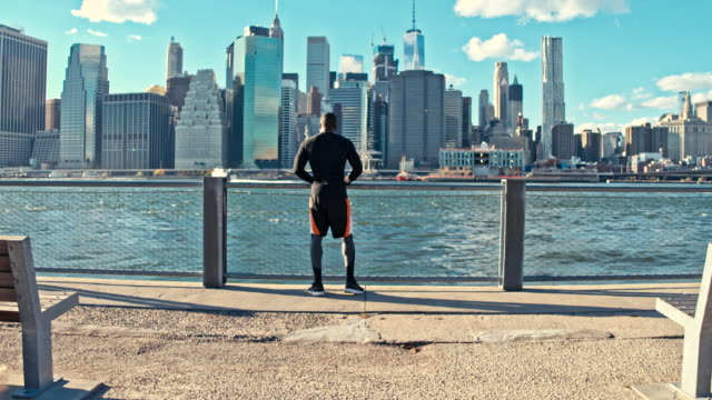 excited young man on promenade after the running new record time - east river stock videos & royalty-free footage