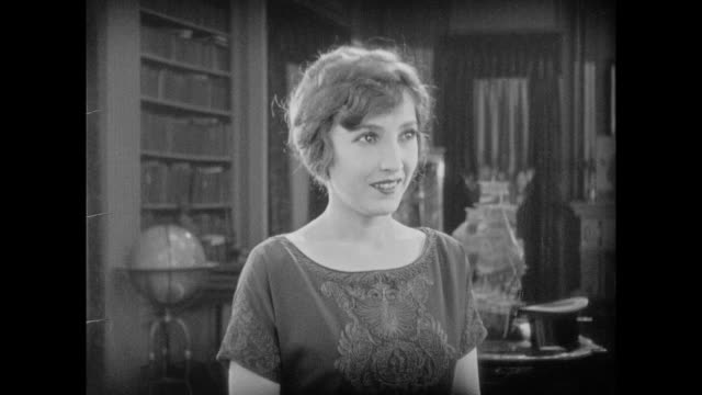 1925 excited young woman is introduced and sits with men in study for discussion - 1925 stock videos & royalty-free footage