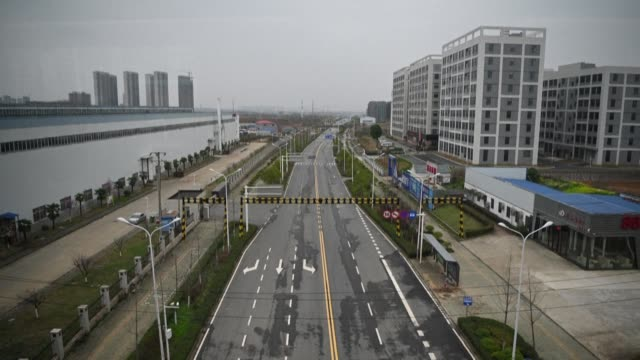 exclusive images shot inside a train show masked passengers the empty streets of wuhan and a deserted train station where only a few disembark - station stock videos & royalty-free footage