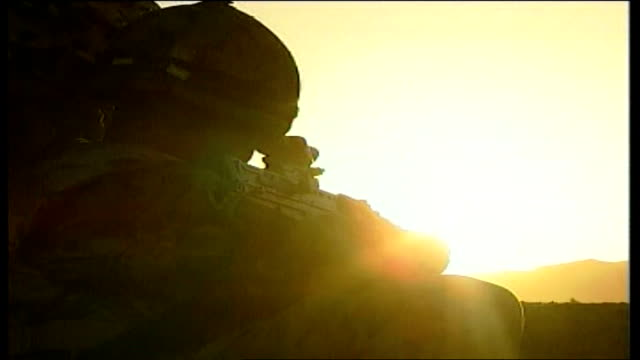 exclusive report from british base in sangin: day 2; afghanistan: helmand: sangin: ext/dusk close back view british soldier, on lookout duty,... - helmand stock videos & royalty-free footage