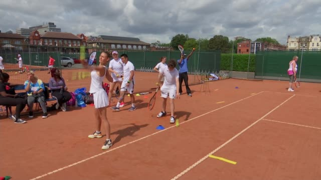 exclusive tennis club queen's club hosts the inclusive tennis festival; uk, england, west kensington, queen's club; lta festival inclusive tennis... - participant stock videos & royalty-free footage