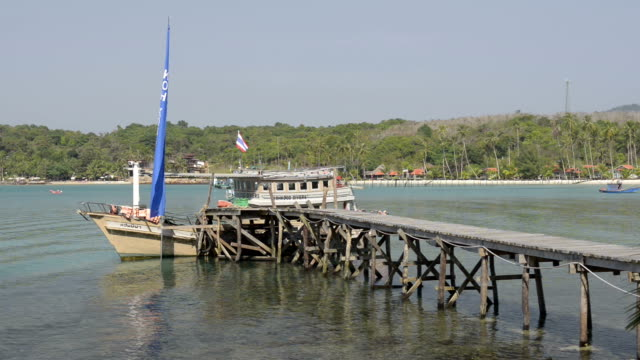 Excursion ship at wooden jetty
