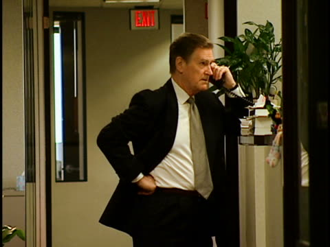 exec on phone - formal businesswear stock videos & royalty-free footage