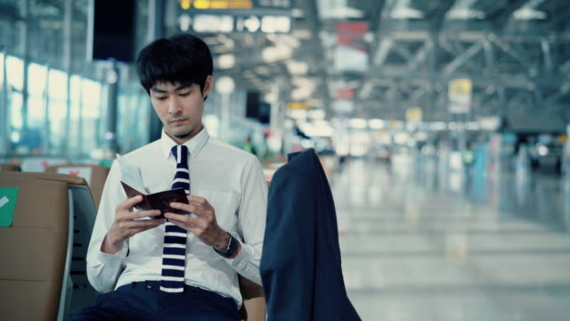 executive checking time while waiting at airport - one mid adult man only stock videos & royalty-free footage