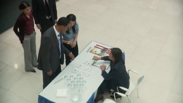 ws ha executive handing out badges at company convention / south orange, new jersey, usa - autographing stock videos & royalty-free footage