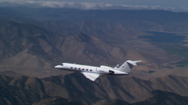 executive jet approaching  - private jet stock videos & royalty-free footage