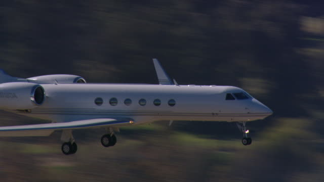executive jet landing - private jet stock videos & royalty-free footage