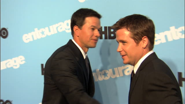 HD Executive Producer Mark Wahlberg Kevin Connolly greeting posing together on carpet outside Ziegfeld Theater posing for press photographs