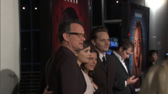 executive producer tom hanks cast ginnifer goodwin melora walters matt ross standing together on red carpet outside cinerama dome posing for press... - シネラマドーム点の映像素材/bロール