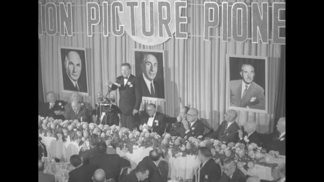 executive standing at podium at head table in starlight roof banquet hall in waldorf astoria hotel giving speech about warner brothers jack albert... - warner bros stock videos & royalty-free footage