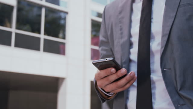 Executive using smart phone in the city