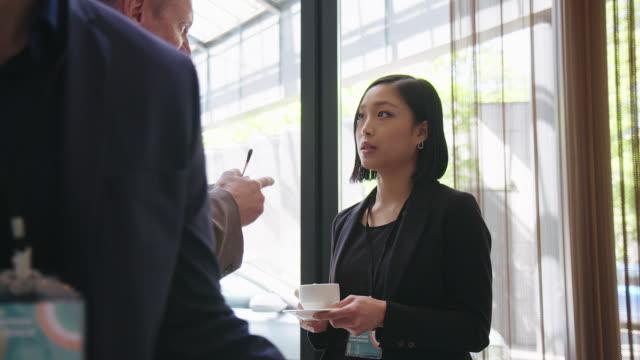 executives discussing during break at seminar - coffee break stock videos & royalty-free footage
