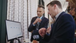 Executives discussing over tablet PC in hotel