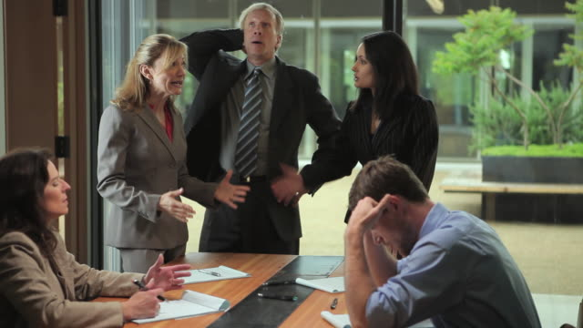 ms executives having heated argument in conference room meeting / portland, oregon, usa - fighting stock videos & royalty-free footage